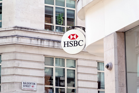 LONDON - JULY 1, 2014: HSBC Bank branch in London, United Kingdom. It is the world\ Editorial