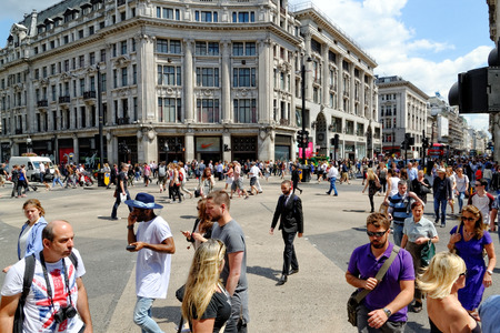 LONDON - JULY 1, 2014: People crossing at Oxford Circus in London. It\