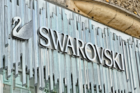 LONDON - JULY 1, 2014. Swarovski store on Oxford street. Swarovski is an Austrian producer of luxury cut lead glass (crystal). The brand exists since 1895 and has 24,841 employees (Dec 2009).