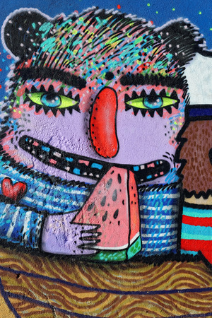 Varna, BULGARIA - December 14, 2014: Street art by unknown artist of a colorful creature close to Port of Varna.
