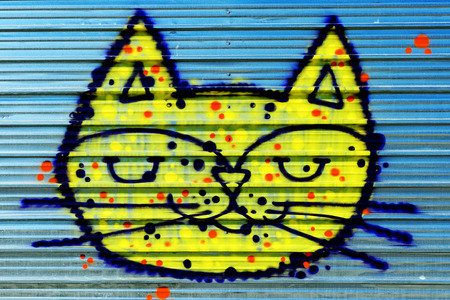 Varna, BULGARIA - December 14, 2014: Street art by unknown artist of a colorful creature resembling a cat close to Port of Varna. Editorial