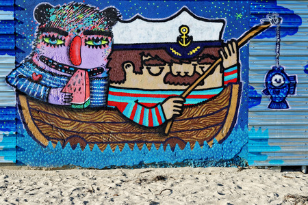Varna, BULGARIA - December 14, 2014: Street art by unknown artist of a captain holding a fishing rod close to Port of Varna.
