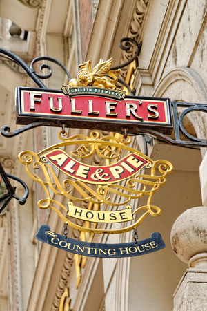 LONDON - JULY 01, 2014: Sign of the Fullers chain of pubs. The Counting House pub on 50 Cornhill, London EC3V was built in 1893 as a magnificent banking hall.