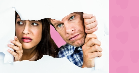 Digital composite of loving couple on graphic background Stock Photo