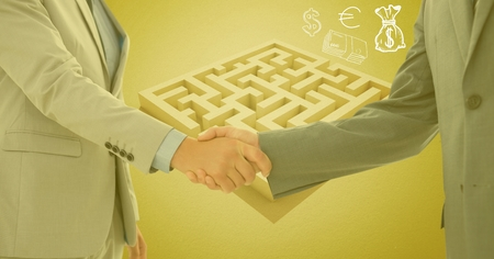 Composite image of businessman and woman shaking hands outside maze with money symbols