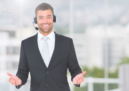 customer facing: Portrait of businessman wearing a headset and smiling