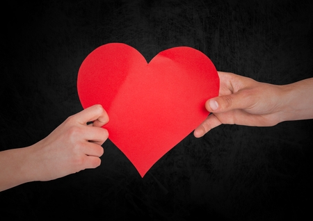 taking a wife: Couple with heart and black background