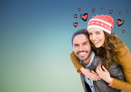 Composite image of man giving piggyback ride to woman Stock Photo