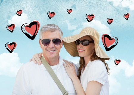 Composite image of happy couple together on vacations against cloudy sky with heart shapes