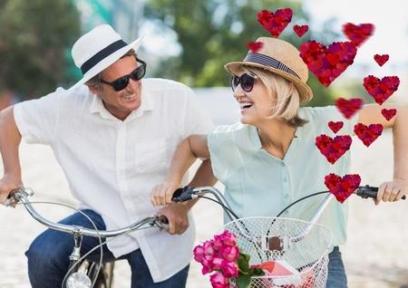 Composite image of romantic senior couple having fun Stock Photo
