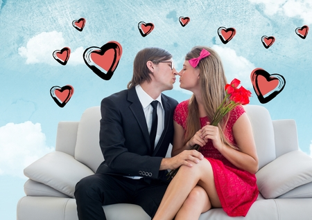 together with long tie: Composite image of romantic couple kissing on sofa against hearts and sky in background