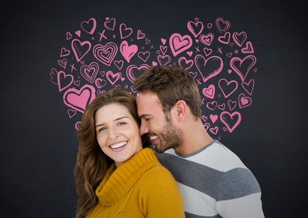 Composite image of couple embracing each other against hearts in background