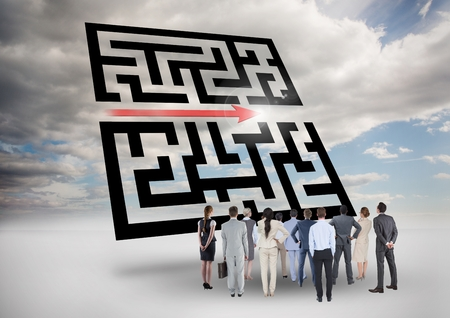 Composite image of businesspeople standing and looking at maze