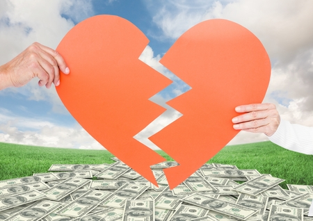 Composite image of couple holding broken heart against money in background