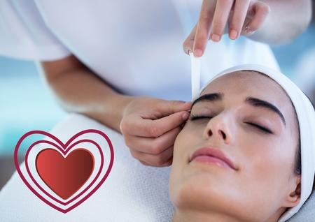 plucking: Beautiful woman receiving massage at spa center