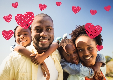 Portrait of happy family with digitally generated hearts