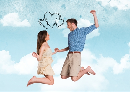Composite image of black hearts and excited couple jumping with hearts against sky Stock Photo