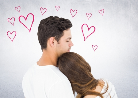 Couple embracing each other against digitally generated background Stock Photo