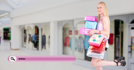 Digital composite image of search bar and woman holding shopping bag and gift box Stock Photo