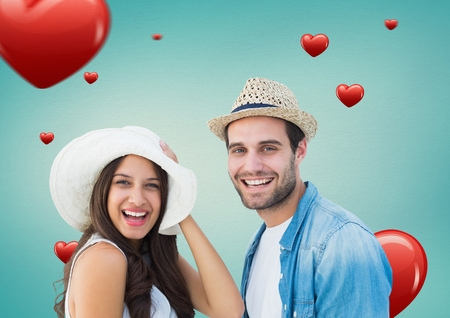 long hair boy: Portrait of happy couple smiling against digitally generated heart background