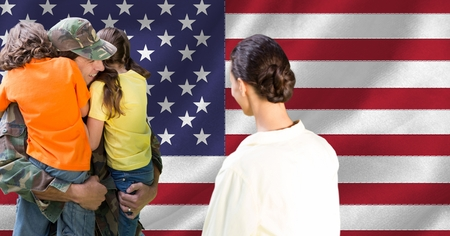 national identity: Soldier hugging his kids and mother looking at them against american flag