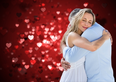 Mature couple embracing each other against digitally generated background Stock Photo
