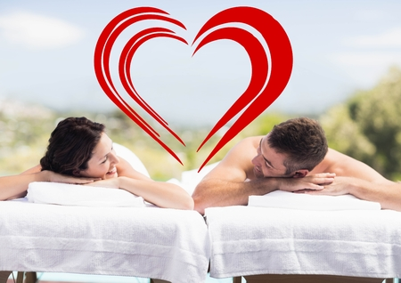Composite image of couple relaxing together at spa center after a beauty treatment Stock Photo