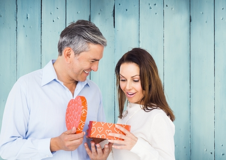floor covering: Couple holding heart box against blue panel