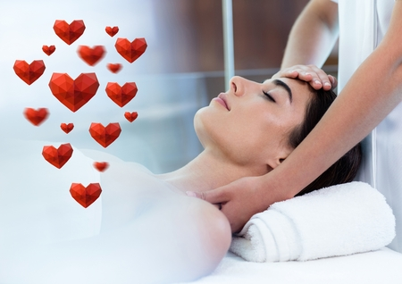 Composite image of beautiful woman receiving spa massage