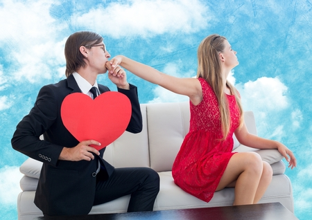Man with red heart pleasing upset women against digitally generated sky background
