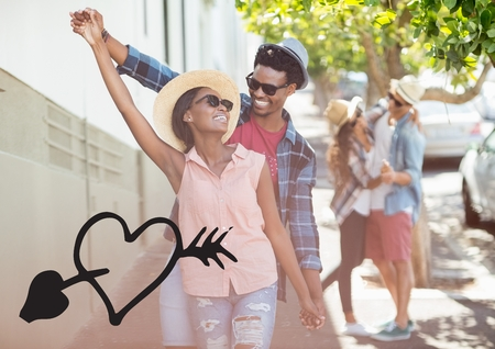 Happy couple dancing on street with black heart Stock Photo