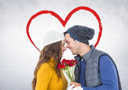 Romantic couple with face to face holding roses with digitally generated heart