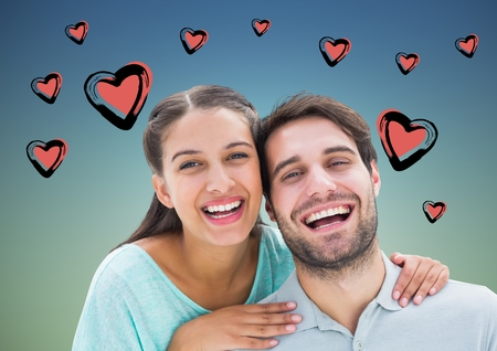 Portrait of happy couple smiling against digitally generated heart background