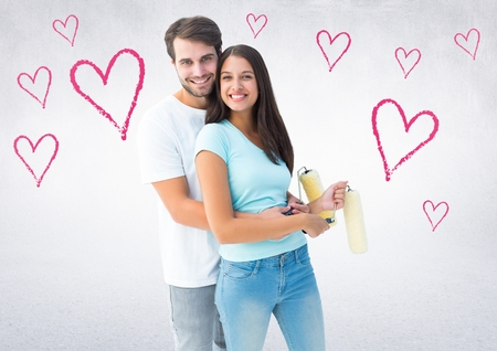 Portrait of happy couple embracing each other against digitally generated heart background