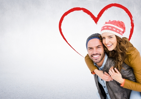 bobble: Digitally generated image of happy man giving piggy back to woman against white background Stock Photo
