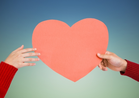 Close-up of hands of couple holding a heart Stock Photo