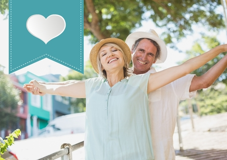 arms outstretched: Composite image of mature couple standing with arms outstretched