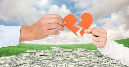 Hand of couple holding broken hearts against digitally generated dollar background Stock Photo
