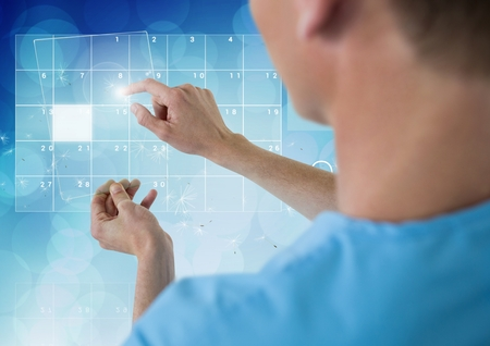Digital composite image of doctor using futuristic touchscreen