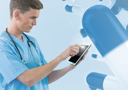 Close-up of doctor using tablet against digitally generated background with capsule Stock Photo