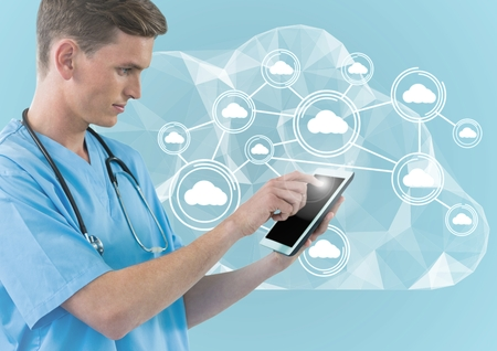 Digital composite image of doctor using digital tablet against cloud computing icons on blue background Stock Photo