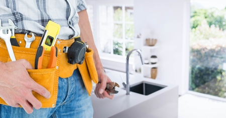 tool belt: Mid section of handyman with tool belt at home