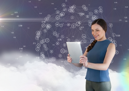 woman tablet: Beautiful woman using digital tablet against digitally generated background