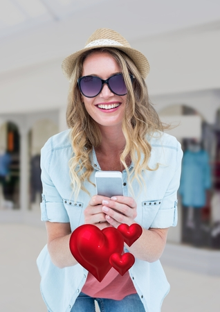 Composite image of happy woman text messaging on mobile phone
