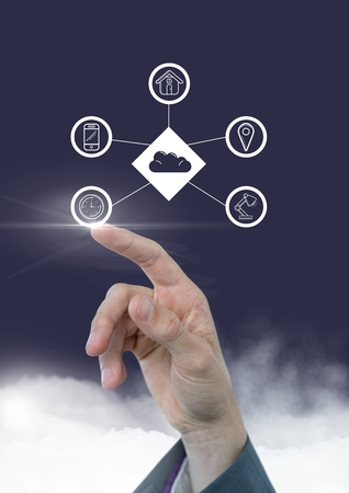 Hand touching digitally generated icons of cloud computing concept Stock Photo