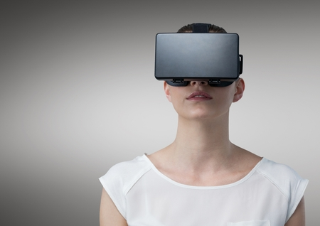 Beautiful woman using vr head set against white background