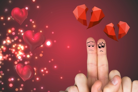 Close-up of sad finger couple with red broken heart