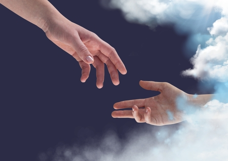 Composite image of two hands reaching towards each other against blue sky background Archivio Fotografico