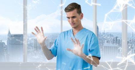Doctor using digital screen against digitally generated background 版權商用圖片