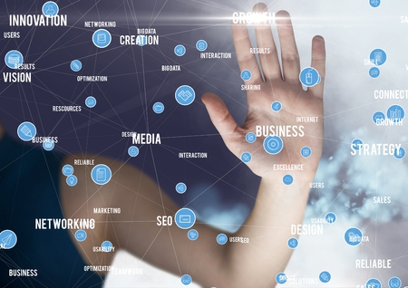 Mid section of businessman touching digitally generated connecting icons Stock Photo